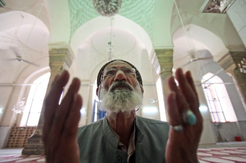 A man prays at Sunni mosque