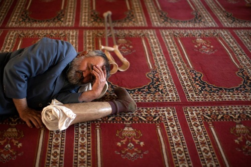 a man takes a nap between prayers