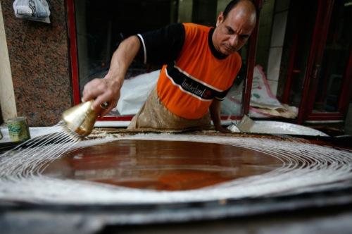 egyptian man makes dessert