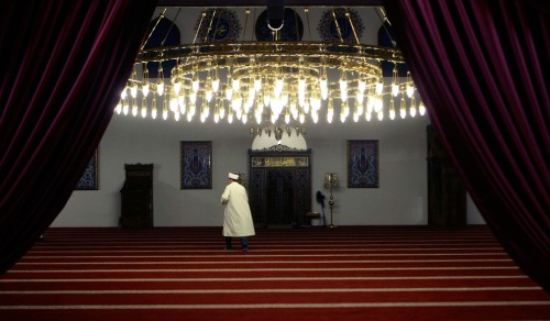 man arrives for the evening prayers