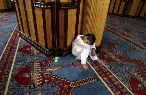 muslim boy takes a nap