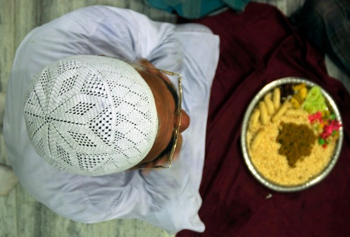 muslim man sit before breaking fast