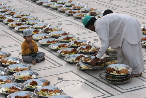 pakistani muslim arranges food stuff