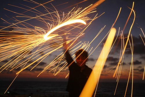 palestinian boy plays with a sparkler